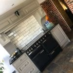 Professionally spray painting kitchen cabinets